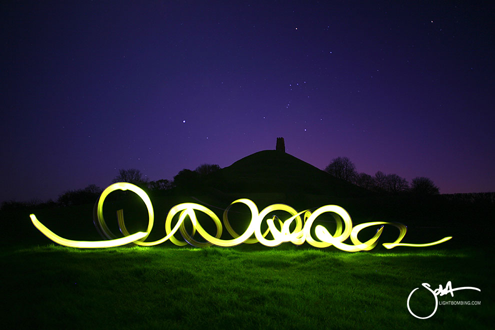 Glastonbury Tor light artist sola golden light under Glastonbury Tor at night