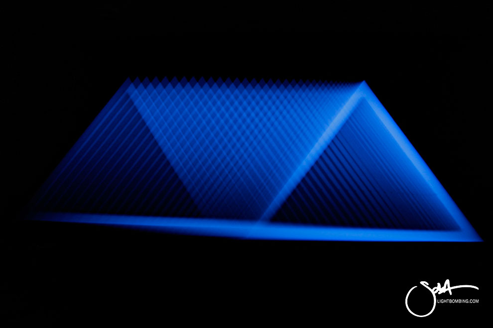 Light Art Geometric Perpetual Portal Blue triangle of light like MC Escher