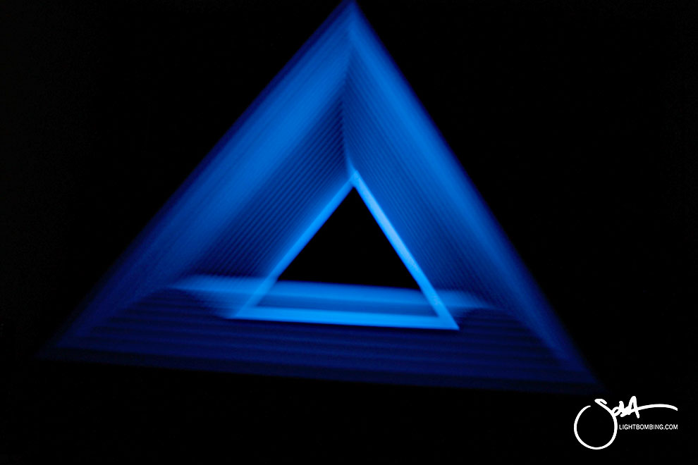 Light Art Geometric Perpetual Portal Blue triangle of light like MC Escher mystic light