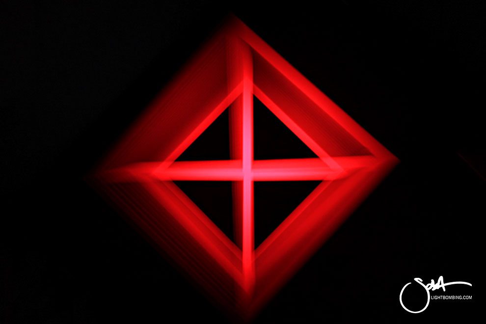 Light Art Geometric Perpetual Portal red triangle of light like MC Escher