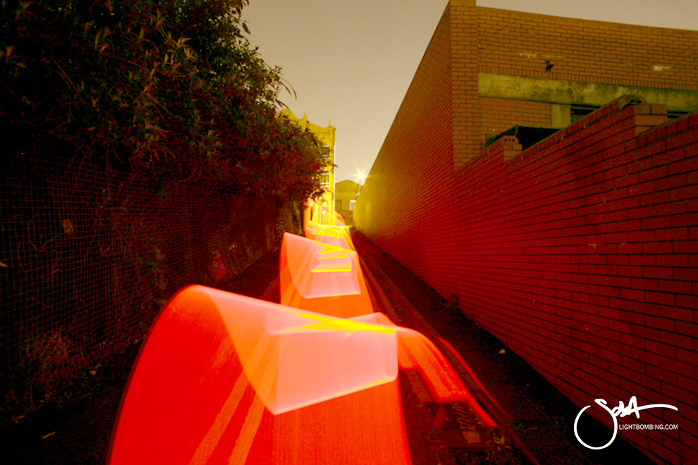 Light Painting Light Graffiti Master Best by Sola red ribbon of light in city street