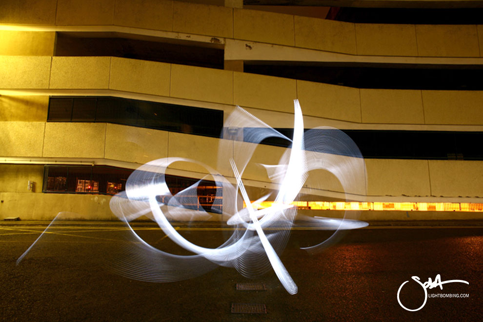 Light Painting Light Graffiti Master Best by Sola Light Sculpture in a city street car park Sola