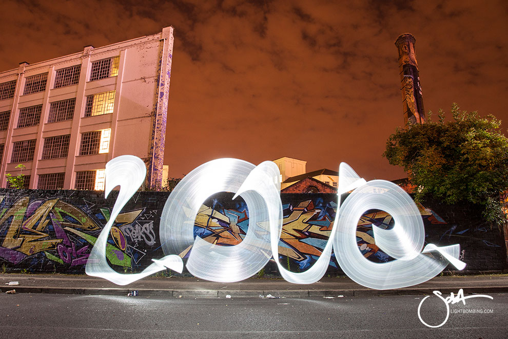 Giant word LOVE in light Light Graffiti Light Painting Sola Master Pixelstick light graffiti in urban city